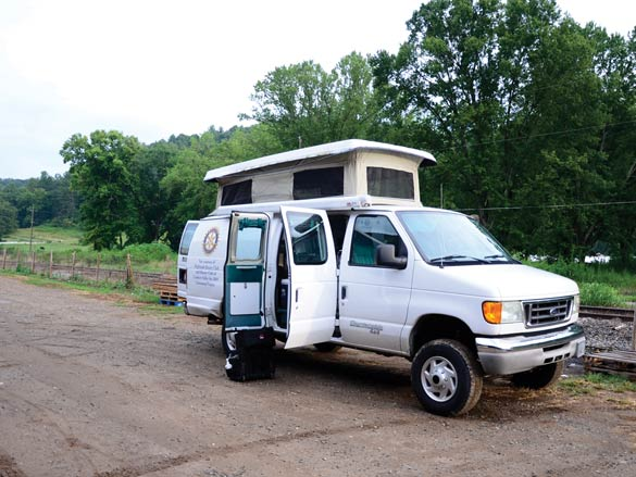 The Vecinos van stands ready for workers to return from the fields.
