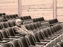 Haywood Arts Regional Theatre Executive Director Steven Lloyd sitting in the seats of the Performing Arts Center building in Waynesville. Garret K. Woodward