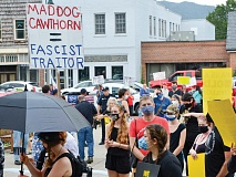 A group of Cawthorn supporters from the Haywood County GOP (background) watches as anti-Cawthorn demonstrators hold a rally Sept. 19. Cory Vaillancourt photo
