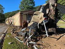 Damage to vehicles and dwellings is widespread near the Cruso Community Center this morning following the massive floodwaters last night.
