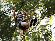 A camper prepares to release herself from the anchor to take an adrenaline-inducing ride on the 'swing' at Nantahala Outdoor Center. Holly Kays photos