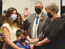 Surrounded by his family on Oct. 4, Richard French takes an oath of office for the new Council term. Later that morning, his fellow representatives elected him Council chairman. Holly Kays photo