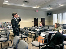 Tom Maher, executive director for Indigent Defense Services Office of North Carolina, speaks to lawyers Brad Ferguson and Karla Wood about the pretrial release program. Jessi Stone photo