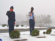 Cadets from the Tuscola High School AFJROTC place wreaths in Green Hill Cemetery the morning of Dec. 16. Cory Vaillancourt photo