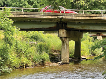Rusty joints and crumbling concrete are visible on this bridge over Richland Creek in central Haywood County. Cory Vaillancourt photo