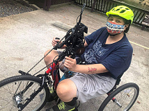 The handcycle allows Bradley, whose legs are paralyzed, to power the bike with her arms. Donated photos
