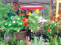 Walter and Joanne Meyers display a bounty of plants for sale during a pre-COVID farmers market. Donated photo