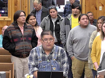 Surrounded by his fellow Cherokee language learners, Matt Tooni addresses Tribal Council regarding the group's request for $15 million in funding to support language preservation programs. ECBI image