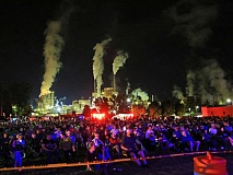 The crowd at the Grit and Grace benefit, with the Evergreen paper mill in the background. Jeff Delannoy photo
