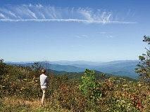 In a 2018 photo, Jordan Smith of Mainspring Conservation Trust looks out from a 5,462-foot view atop the Blackrock property. Holly Kays photo