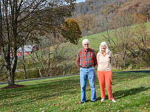 Joe and Sue Morrow live at the bottom of the mountain they recently gave for Haywood Community College's use as a teaching forest. Holly Kays photo