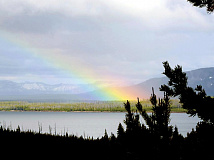 A rainbow falls across Yellowstone Lake  in Wyoming. Holly Kays photos