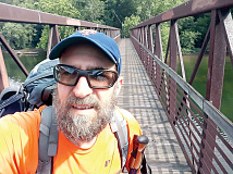 Joe 'Triton' Schmidt, founder of the Facebook group Still on the A.T, crosses the James River during an 800-mile section hike last year. Donated photo