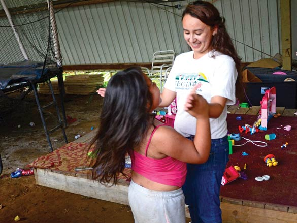 Karla Mendoza spends a slow moment at the clinic playing with 7-year-old Greidyss. Holly Kays photo