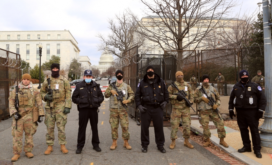 Capitol Police and National Guardsmen stand before a checkpoint on Washington, D.C.'s South Capitol Street on Jan. 19.