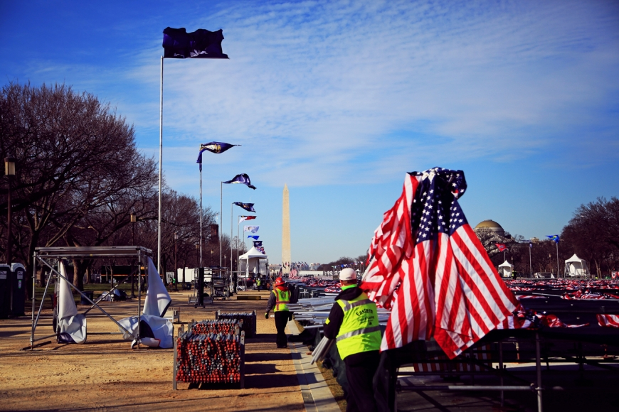 Workers remove what's left of the inaugural ceremonies in Washington D.C. on Thursday, Jan. 21.