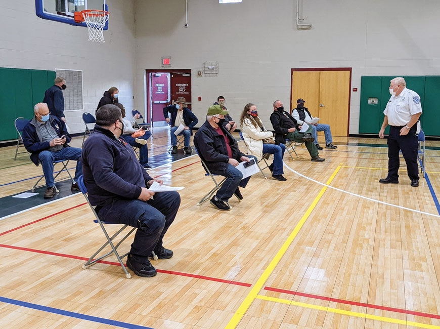 Vaccine recipients wait for the 15-minute observation period required during a clinic for first responders Jan. 15.