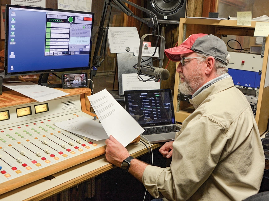Bluegrass legend Tim Surrett behind the microphone of WPTL during his twice-weekly show 'Papertown Roots Radio.' (photo: Garret K. Woodward)