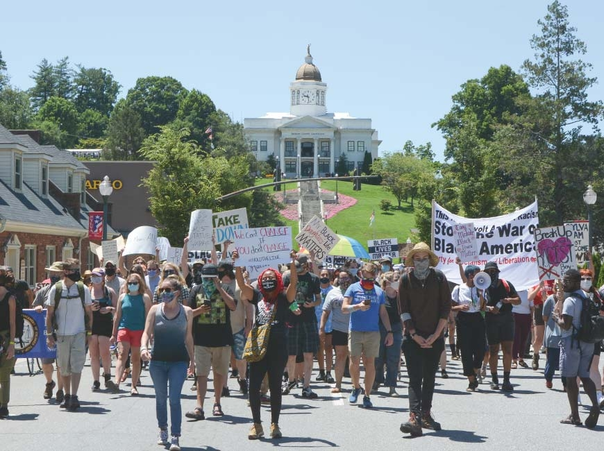 Protestors took to the streets July 11 to show their opposition to the Confederate solider statue on the hill below Sylva's historic courthouse, now the Jackson County Public Library.