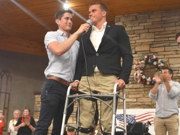 Madison Cawthorn, who mobilizes using a wheelchair, stands to address supporters at his June 23 victory party. Cory Vaillancourt photo