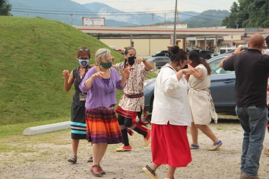 Nikwasi Initiative Executive Director, Elaine Eisenbraun, joins the Cherokee Culture Keepers in Bear Dance to celebrate groundbreaking at new Kiosk site.