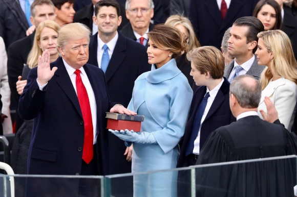 President Donald Trump (left) takes the oath of office