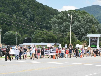 More than 100 BLM demonstrators (left) marched down Soco Road on Aug. 1. Garret K. Woodward photo
