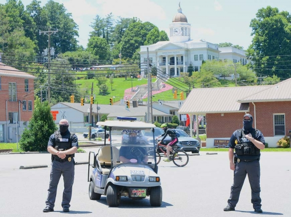 Masked police officers monitor the protest event at Bridge Park. Holly Kays photo