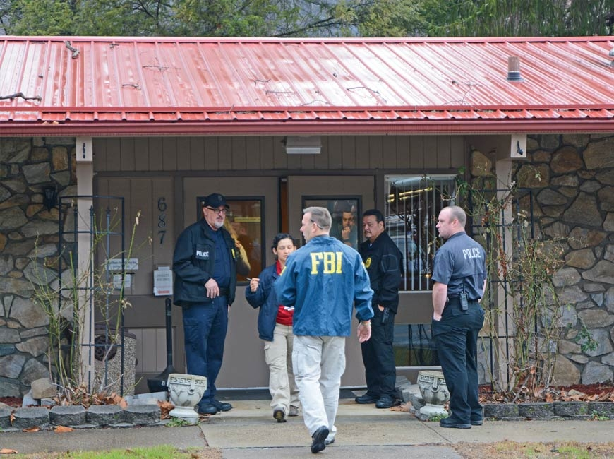 FBI agents raid the Qualla Housing Authority building in February 2017. Holly Kays photo