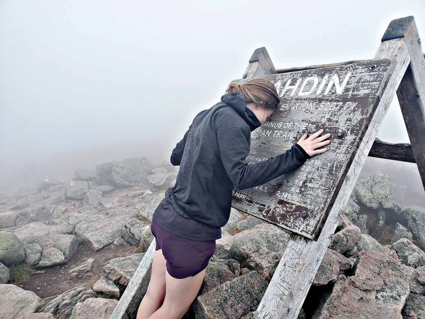 Karly Jones takes a moment to reflect after summiting Mount Katahdin.