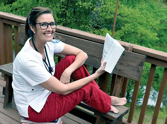 With in-person classes and clinicals canceled, nursing student Stephanie Morton adopts the deck as her new office. Donated photo