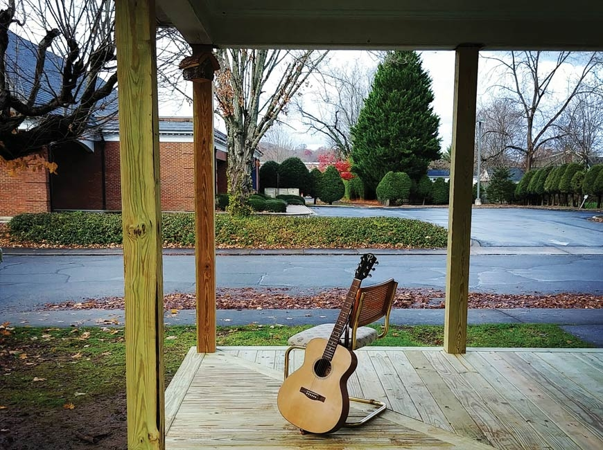 Guitar strumming on the new porch. (photo: Garret K. Woodward)