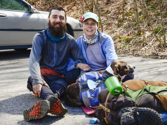 Thru-hikers Greg Boului and Cricket Cote wait for a shuttle at Winding Stair Gap with their dog Roux. Holly Kays photo