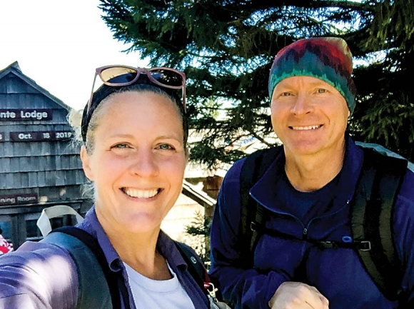 Nancy East (left) and Chris Ford pause for a photo after summiting Mt. LeConte. Donated photo