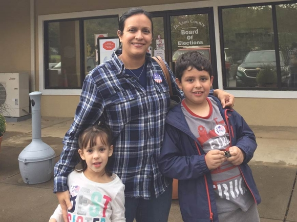 Luisa Teran de McMahan and her children, Henry and Annie, sport 'I voted' stickers following McMahan's first trip to the polls as an American citizen. Donated photo