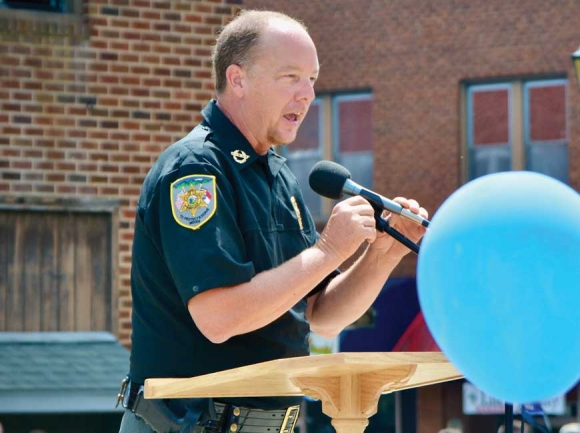 Macon County Sheriff Robert Holland speaks at a back the badge rally in Franklin on July 25. Cory Vaillancourt photos