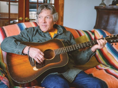 Singer-songwriter Chris Minick at his home in Waynesville. Garret K. Woodward photo