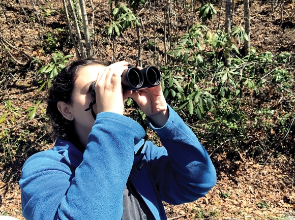 Naturalist Nicole Cook takes a closer look at a bluebird. Donated photo
