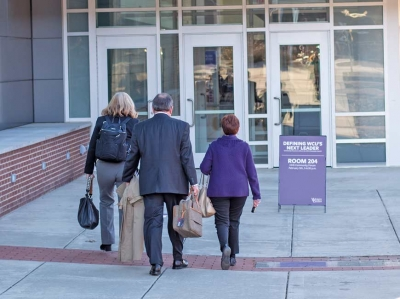 Pat Kaemmerling, chair of the Western Carolina University Board of Trustees and co-chair of the search committee, walks into the Feb. 5 community forum with some of her fellow search committee members. Holly Kays photo