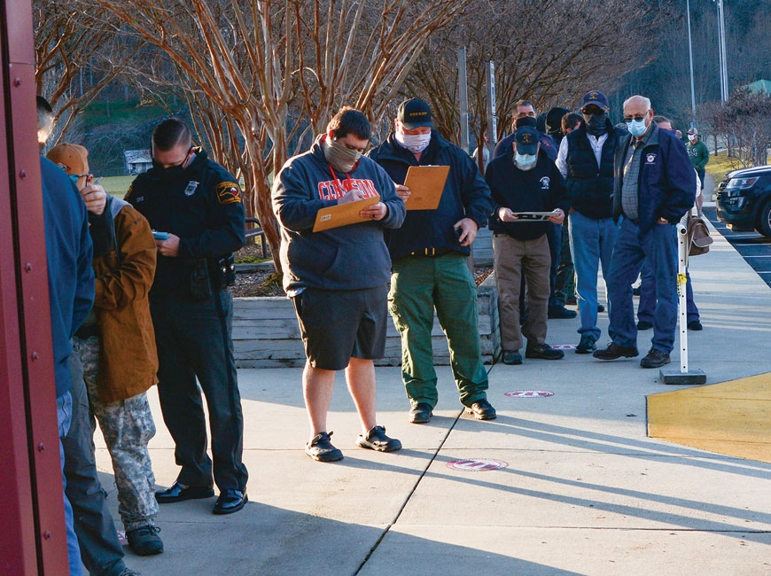 First responders line up outside the Cullowhee Recreation Center Jan. 15 to receive their first COVID-19 vaccination shot. Holly Kays photo