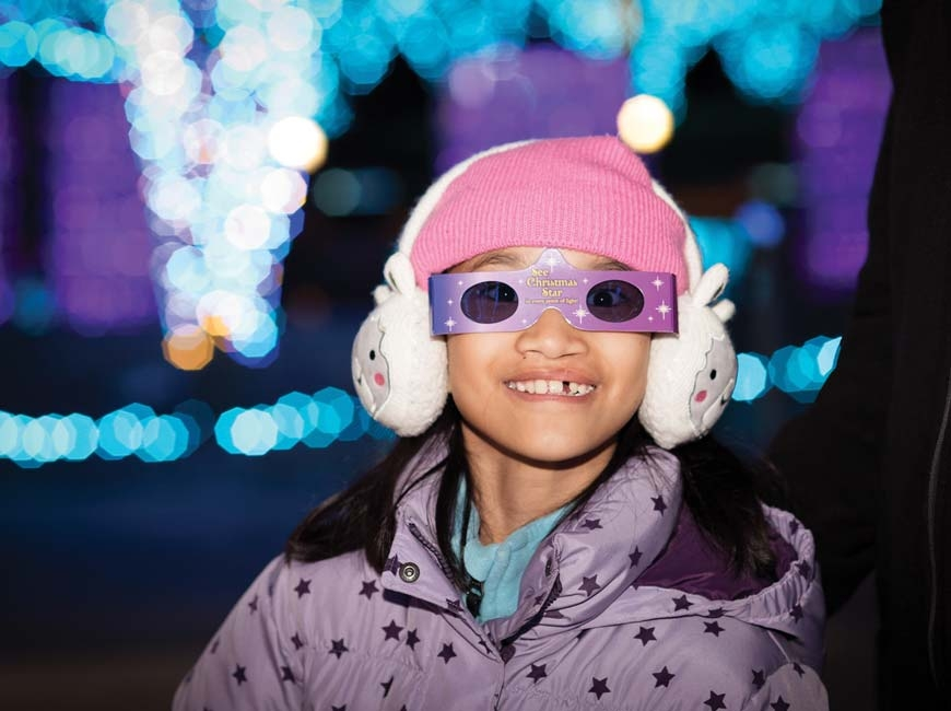 A young guest enjoys last year's light show. Cami Calnan photo
