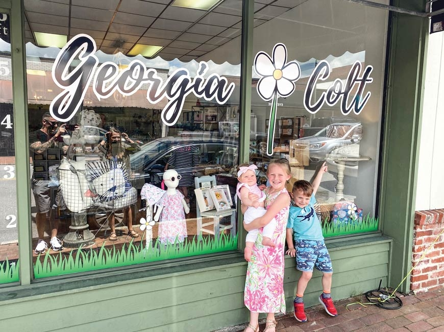 Georgia, Colt and Daisy Coble pose in front of their dad's new store.