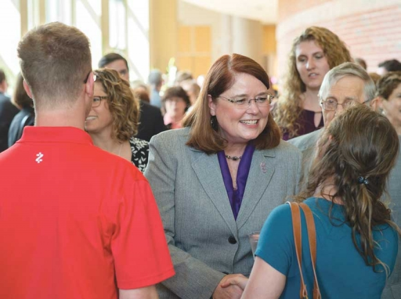 Dr. Kelli Brown shakes hands with WCU students during a reception to welcome the chancellor-elect to the university. WCU photo