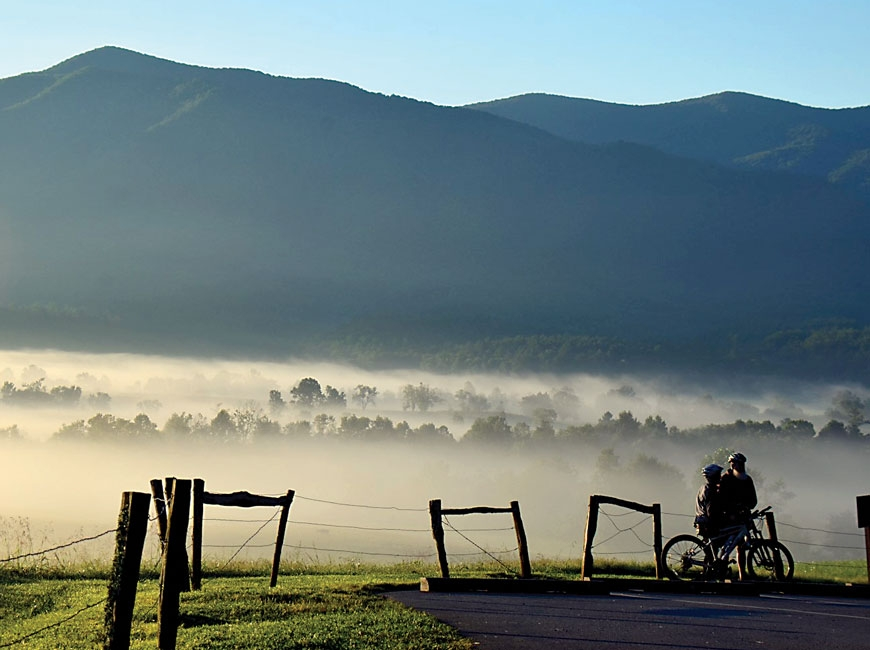 Cyclists take a break during a ride on Cades Cove Loop Road. NPS photo