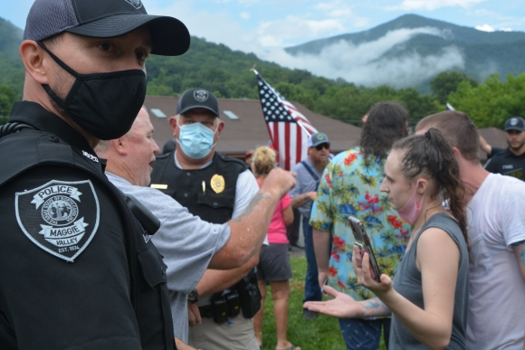 Demonstrators and counterdemonstrators argue under the watchful eye of the Maggie Valley Police Department on July 18