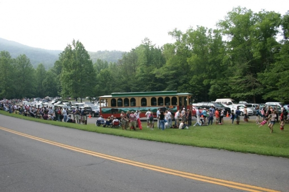 Visitors wait for the trolly to Elkmont Campground to view the synchronous fireflies during a prior year. NPS photo