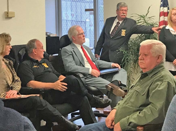 Swain County Sheriff Curtis Cochran and his attorney David Sawyer discuss Jerry Lowery's candidate challenge with the two members of the board of elections. Jessi Stone photo