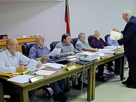 Swain County Board of Elections Chairman John Herrin speaks to commissioners about unpaid retirement benefits for Elections Director Joan Weeks. SMN photo