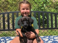 A camper enjoys the chance to cuddle a shelter pup. CHHS photo